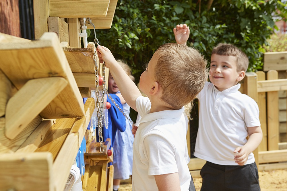 children playing with wooden sensory playground equipment