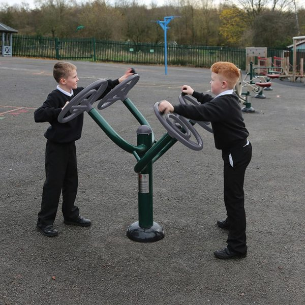 two children using outdoor gym equipment for schools