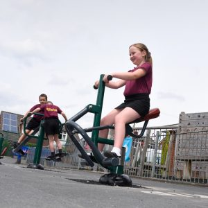 children using outdoor gym equipment for schools
