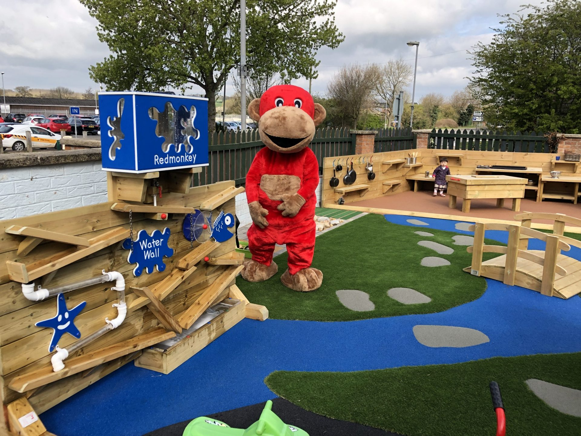 red monkey mascot in outdoor playground area