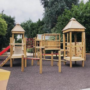 wooden climbing frame with steps and a climbing wall