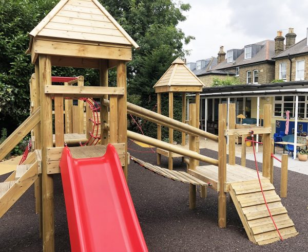 wooden climbing frame in outdoor playground