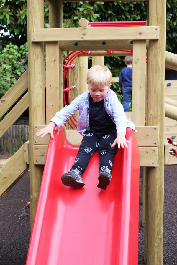 outdoor playground climbing frame slide with girl
